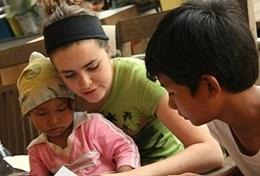 A volunteer interacts with two children during an Occupational Therapy session
