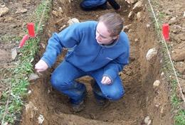 A high school student helps at a dig site in Romania during her Archaeology internship abroad.