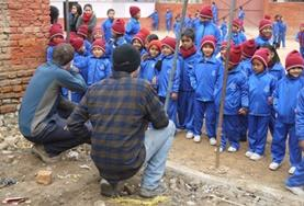 Building volunteers dig at their placement in Nepal