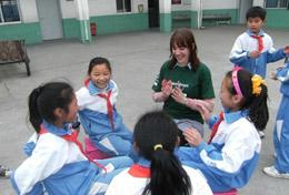 Children interct with a volunteer on a Care and Community placement in China