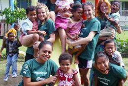 Volunteers and children pose for a picture on a Care and Community Project placement in Fiji