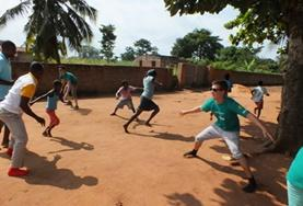 High School Special volunteers play a game with local children in Togo to help with their physical development and teamwork.
