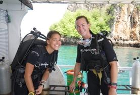 Two High School Special volunteers prepare for a survey dive as part of their marine conservation work in Thailand.