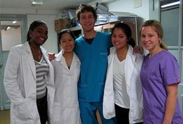 Hospital staff pose with a volunteer on a placement in Cordoba