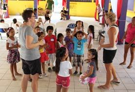 Public Health volunteers work together during a community outreach with local children in Belize.