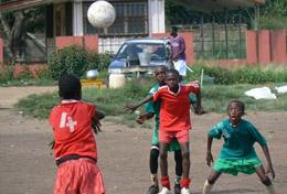 Children play football at a volunteer placement in Ghana