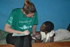 A volunteer and child interact on a Social Work internship in Ghana