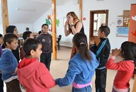 A Social Work Intern works with children at a placement in Romania