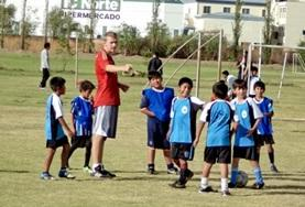 A Football volunteer speaks to his team on a sports placement in Bolivia