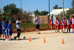 Local school children work on a football drill with a volunteer at our Multi-sports placement in Morocco.