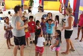 Volunteers address a group of children on a School Sports Project in Belize