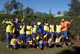 A sports team pose for a picture at a volunteer placement in Kenya