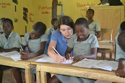 A Projects Abroad volunteer helping her pupils in Ghana, Africa