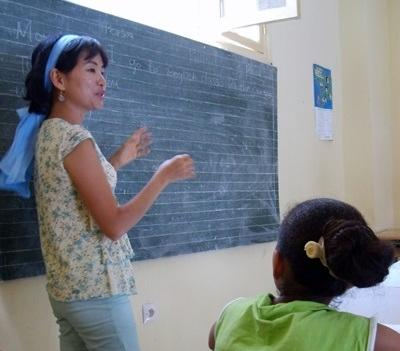 A volunteer demonstrates on the board in a school in Morocco, Africa.