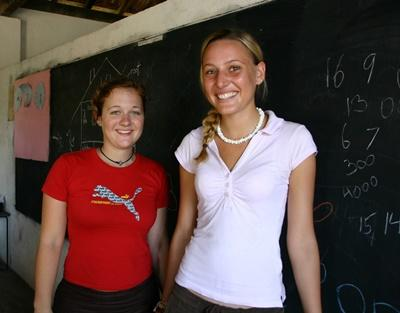 Two volunteers stand together in a classroom in Sri Lanka, Asia.