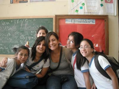 A Projects Abroad volunteer French teacher poses with a group of students