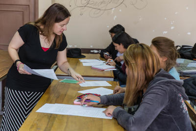 A Projects Abroad French Teaching volunteer instructs students during a lesson in Cochabamba