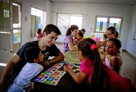 A volunteer interacts with children during his teaching placement at a school in Argentina