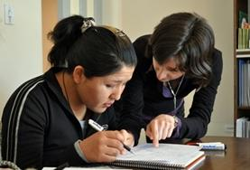 A Teaching volunteer assists a student with work at a placement in Bolivia