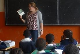 A volunteer reads an English book with her class at our Teaching placement in Ethiopia.