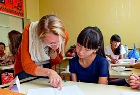 A volunteer works through an English language exercise with a school student at our Teaching placement in Mongolia.