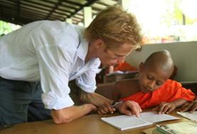 A volunteer guides a young boy through his English homework at one of our Teaching placements in Sri Lanka.