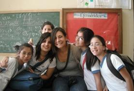 A volunteers poses with children on a French teaching project in Argentina
