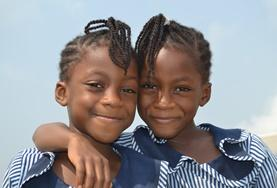 Two children pose for a picture on a placement in Ghana