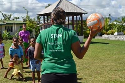 Children enjoy a ball game with a Projects Abroad Care volunteer and a staff member during the daily physical activity session of the holiday school program in Fiji